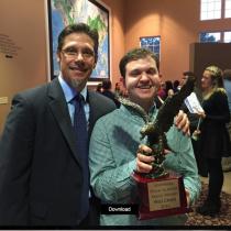 Johnson High School Principal Stan Lewis and Scott Crain holding the Eagle Award